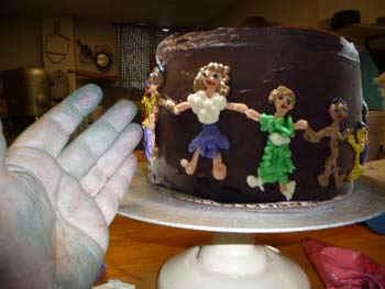 CakeBlueHand.jpg (38263 bytes)
